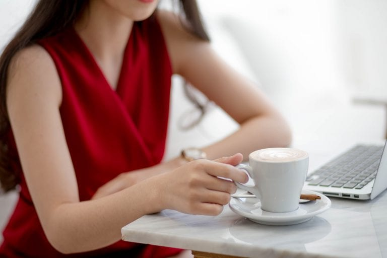 Asian,Women,Holding,Cup,Coffee,On,Desk,Works.select,Focus,Hand